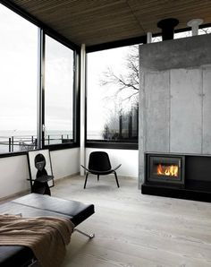 lake view + fireplace in the bedroom