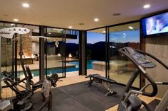 love a personal gym overlooking the pool      i'd loooove this but clearly i'm dreaming haha