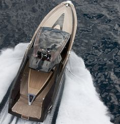The Hedonist Yacht by Art of Kinetik has a solid mahogany hull, Rolls Royce water jets for a smooth ride, premium woods and a stunningly decorated interior.