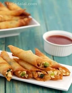 Paneer Chilli Cigars, crispy rolls with a cheesy and spicy paneer stuffing is an interesting starter, especially for dinner on a winter's night. Indian Appetizers, Indian Snacks, Appetizers For Party, Indian Food Recipes, Vegetarian Recipes, Cooking Recipes, Rice Recipes, Snacks Recipes, Party Snacks