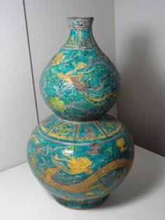Important Ming Dynasty Zhengde Period Dragon Vase H 14 in. This double gourd vase of the Zhengde Period is decorated with a dragon admist clouds and a phoenix admist flowers with a special design called 'Fahua' glaze which was made by detailing the pictures by clay before filling in the colors. This design was invented during the early Ming Dynasty. This vase is marked with four Chinese characters meaning 'Made in Zhengde Period'.