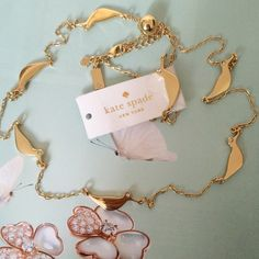 """kate spade scattered bird necklace. Price firm. NWT Kate Spade New York Piper Scatter Necklace. 14 karat gold plated metal chain measuring approximately 30"""" in length with sandpipers scattered throughout. Each sandpiper has a small crystal gem in place of an eye. Lobster claw clasp.   Birds of a feather flock together, and that's no exception for our favorite sandpiper, whose friends are scattered along the length of this gold necklace. each has a crystal embellishment at the eye to offer a…"""