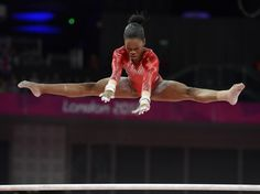 USA gymnast Gabreille Douglas competes on the uneven bars in the women's gymnastics team final during the London 2012 Olympic Games.