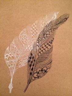 Doodled feathers on a kraft note book