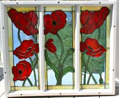 Poppies are for remembrance and these flowers are framed in a window frame from the house I grew up in. They are stained glass and my original glass design.