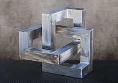 This aluminum sculpture by Kevin Caron never ends .... $1200