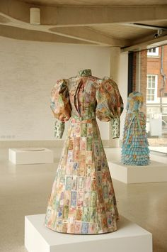 An entire dress made from paper currency and maps! So cool.