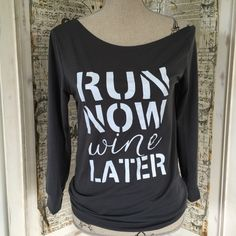 "Run Now Wine Later long sleeve tee Run Now Wine Later long sleeve tee. Gray with white letters. Cotton blend. Measures 25"" in length. Bust approx 36"". Sleeves 21"". Size XL (runs small fits like Sz L) Oblique neck (one sleeve slips off shoulder) Tops Tees - Long Sleeve"