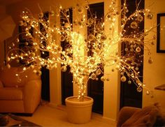 We did a tree similar to this one year and wrapped white lights all over a small leafless tree from the back yard. It was beautiful and different!