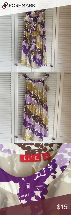 Elle Patterned Dress Size Small Beautiful Elle Patterned dress perfect for a spring or summer activity! Size small and only worn twice. Like new! Super cute paired with a belt and wedges. Elle Dresses Midi