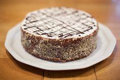 Coconut cream, dark chocolate mousse, walnuts meringue and vanilla sponge.