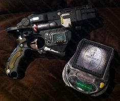 My first Fallout mod and prop. Nerf Proton as a base for the gun and a toy as base for the PIP-Pad PIP-Boy take.
