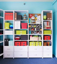 A full wall of storage keeps the meeting room tidy by giving the women a place to keep important items./