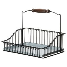This FINTORP Wire basket with handle from IKEA would be useful storage. Could also be good in the bathroom or laundry when I get to re-doing those rooms. $19.95