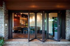 Folding Glass Doors I D Like To Enclose My Front Porch During The Winter But Be Able To Slide The Glass P Door Glass Design Porch Design Folding Patio Doors