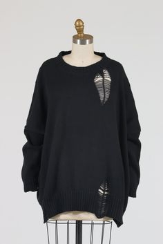 """PLANET by Lauren G's Shredded Sweater is a cozy chunky-knit sweater with of-the-moment shredded """"hole"""" details. Sweetly designed like a heart at your left front shoulder, and with more shreds scattere"""