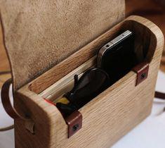 Oak Wood Bag by Haydanhuya / The Oak Wood Bag by Haydanhuya is handmade using one piece of oak wood and vegetable tanned leather. http://thegadgetflow.com/portfolio/oak-wood-bag-by-haydanhuya-235/
