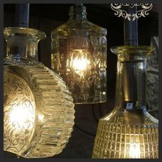 Upcycle pretty bottles as uniquely attractive light fixtures.