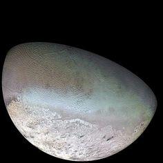 triton (non spherical, large moon of neptune)
