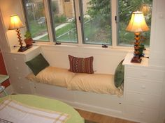 Cozy nook -- built-in bench, storage in dining room by KMF Construction