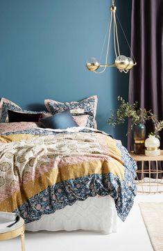 Slubbed cotton adds subtle texture to a medallion-patterned duvet cover that enhances the vintage appeal of your bedroom décor.