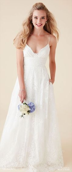 Dreaming of a gasp-worthy wedding dress that also has pockets? Luna is your girl! Framed by spaghetti straps, a daring camisole neckline and low back offer flirty balance to her classic Chantilly lace overlay. A wide belt narrows the waist, from which falls a full, fluid skirt and chapel train.