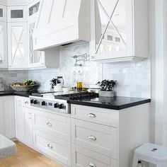 Mirrored Kitchen Cabinets With Marble Tiles