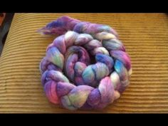 Breaking Wilton's Violet Food Coloring on Handpainted Roving NOTE: she JUST got her new spinning wheel, she is a bit giddy
