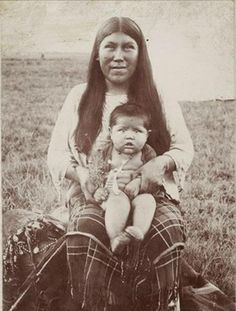 "A ""kohno"" (day cradle) was used to keep a Comanche baby out of harm's way or, if a mother was gathering seeds or roots and on the plains, it could be easily carried along her back. This photos shows a Comanche ""pia"" (mother)  her ""onaa"" (baby) ca. 1899. The ""kohno"" lay next to her right side."