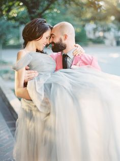 Romantic Bridal Carry Photo | The Happy Bloom | http://heyweddinglady.com/modern-preppy-wedding-shoot-coral-gray/