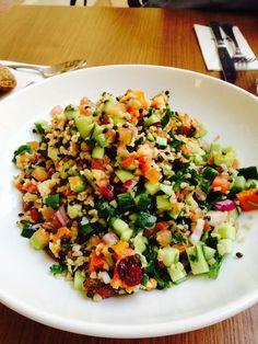Lettuce, Tomato, Cucumber, Sweet Potato, Bulgur, Black Lentils, Cranberries, Fresh Herbs, a Granola Sprinkle in a Lemony sweet dressing