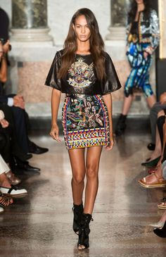 Peter Dundas mixed athletic shapes and Masai warriors for spring, with a hint of hip hop. The blending was literal, but it somehow all worked in an explosion of tight color, pattern and leather.   - HarpersBAZAAR.com