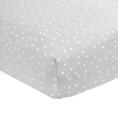 """Create tender moments in your baby boy or girl's nursery with this Carter's easy-fit sateen crib sheet featuring a modern soft grey sheet with a white star print. This 200 thread count fitted crib sheet provides extra softness for your baby's comfort. It's crafted using 100% cotton with reinforced corners for a secure and premium fit, ensuring a safe sleep. This versatile crib sheet fits standard crib mattresses (28"""" x 52"""") and is a great base piece for any nursery, allowing you to mix and…"""