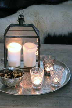Set the coffee table with lanterns, candle lights and sweets for long and cold evenings. Products from tinekhome.com