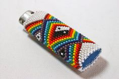Stunning beaded lighter case with rainbow and yin yang design on both sides. Made with peyote stitch using opaque seed beads (size 10), white