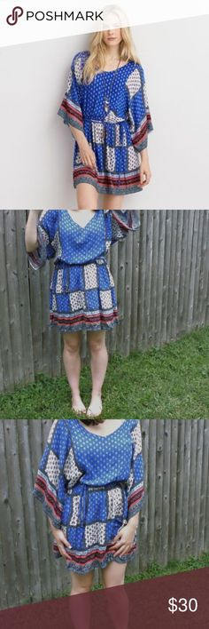 AEO Patchwork Flowy dress in navy This dress is NWT from American Eagle. It has a patchwork design and a V-neck cut. It has a tie at the waist as well as a keyhole cutout in the back. American Eagle Outfitters Dresses