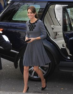 The Duchess of Cambridge, 33, wearing a chic Orla Kiely dress, showed no sign of fatigue after last night's Bond premiere as she arrived at a child mentoring programme in north London on Tuesday