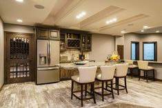 Basement bar - mix of rustic and contemporary. Built-in wine storage. Fluff Interior Design - Decorating for REAL life. White Leather Bar Stools, Bar Mix, Rustic Basement, Family Room Design, Wine Storage, Contemporary, Modern, Sweet Home, New Homes