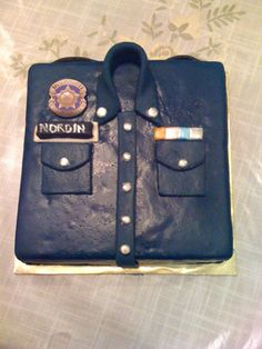 Police cake... but could it possibly be a firefighter cake???