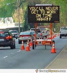 You'll never get to work on time. Haha! Funny street sign.