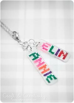 Shrinky-Dink charms - trace Xs with colored markers for a faux cross-stitch. Nifty!
