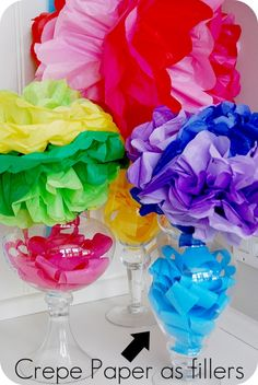crete paper poufs, wreaths, and vase filler