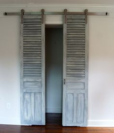 Are you tired of your plain old closet doors? We have plain bi-fold doors, and they're the worst! So on our quest to spruce them up, we've found 18 closet door makeovers with real wow factor. Some are easy (just paint tricks) while others require a l The Doors, Sliding Doors, Wood Doors, Front Doors, Bifold Barn Doors, Front Entry, Door Fittings, Old Shutters, Repurposed Shutters