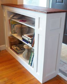 Really cool built in shelf idea to separate my hallway from the playroom