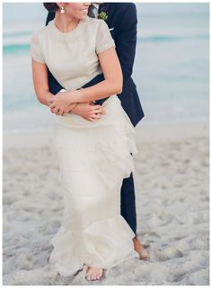 Photo Inspiration: Bride and groom on the beach. Wedding dress by Gossamer Vintage, image by Gianny Campos Photography.