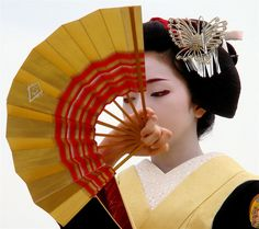 The maiko (apprentice geisha) Konomi performing a dance with a fan at the Heian Shrine in dedication to the arrival of spring.