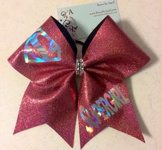 Bows By April Express - SUPERGIRL Rose Glitter with Prism Cheer Bow, $18.00 (http://www.bowsbyaprilexpress.com/supergirl-rose-glitter-with-prism-cheer-bow/)