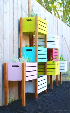 Rainbow Vertical Garden DIY: This little box garden is perfect for those gardeners with small backyards! Check out how to make your own.