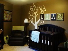 I love the warm feeling of this room.  The leather chair is very useful, comfy, and sophisticated in a baby's room.  Also love the name above the crib!