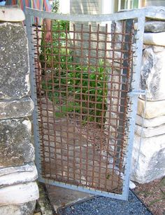 Iron, galvanized metal gate. Poth and Gill.